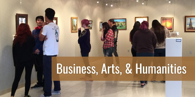 Business, Arts and Humanities - Students in a museum viewing and discussing art.
