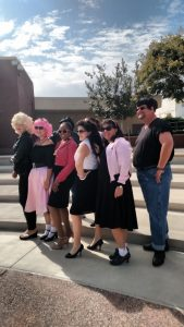 Faculty in Grease costumes